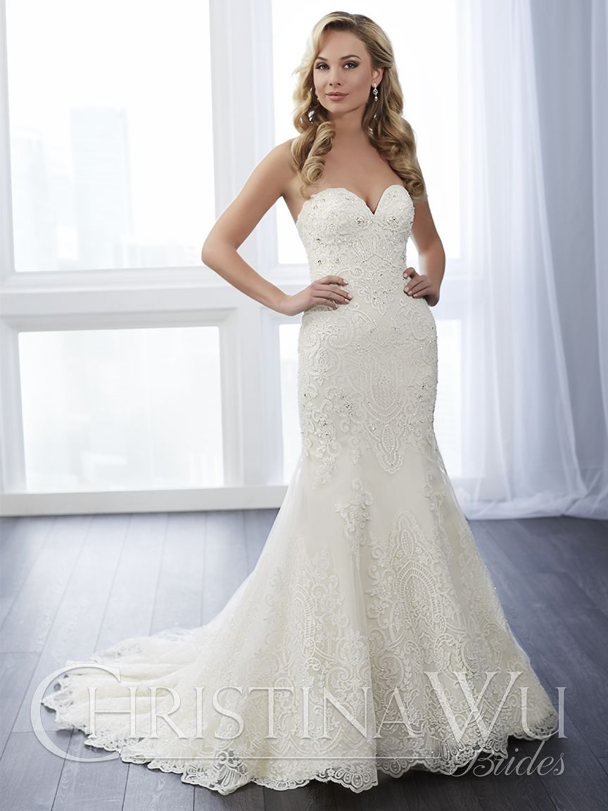Timeless lace is complimented by rich beading in this classic