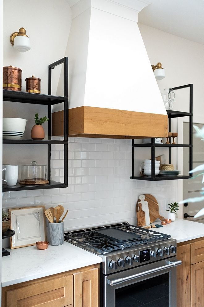 Kitchen wood stained cabinet with kitchen hood featuring ...