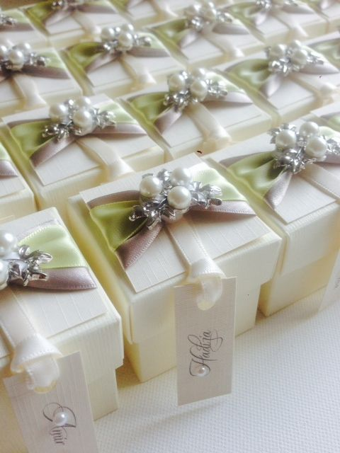 Yellow and silver themed wedding favour boxes decorated with beautiful elegant pearl brooch and wedding guests name printed on a tag that is attached to the ... & Yellow and silver themed wedding favour boxes decorated with ...