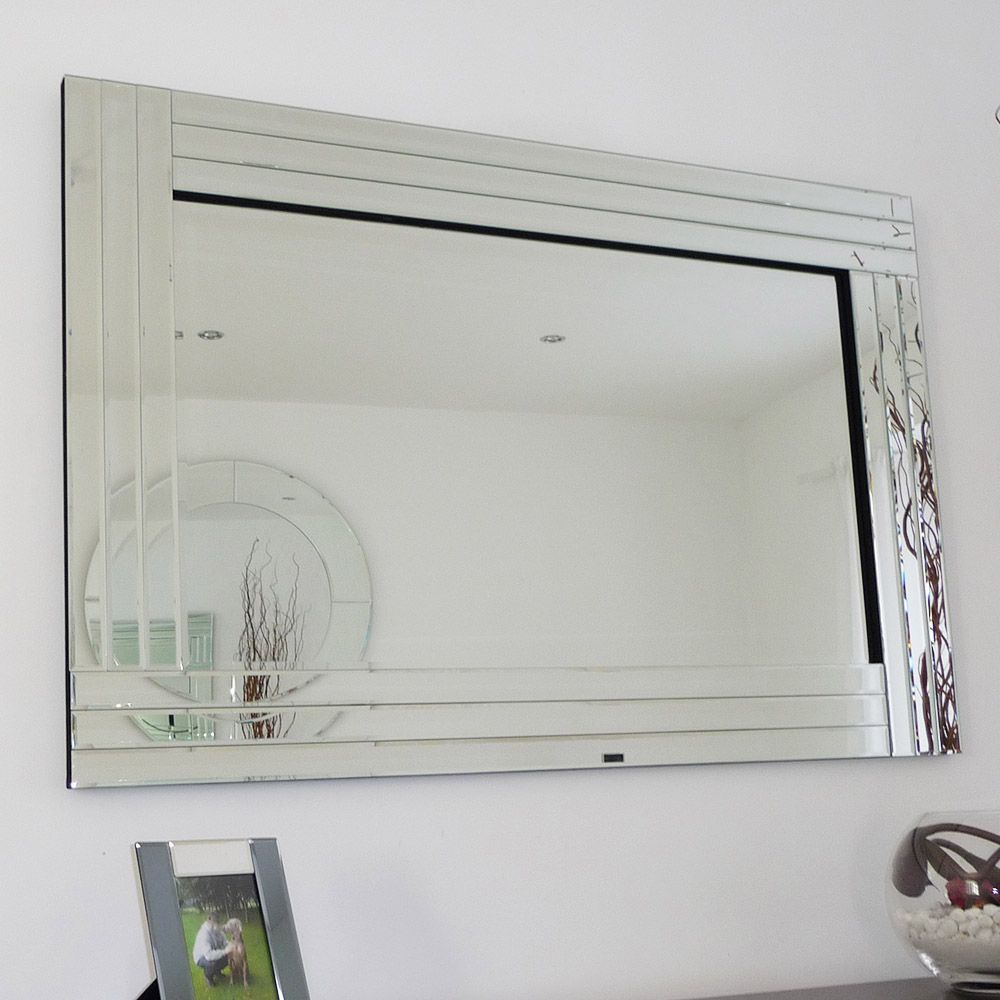 This bevelled glass mirror with a \'triple\' glass cut frame is a ...