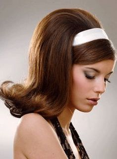 1960s big teased flip hairdo.