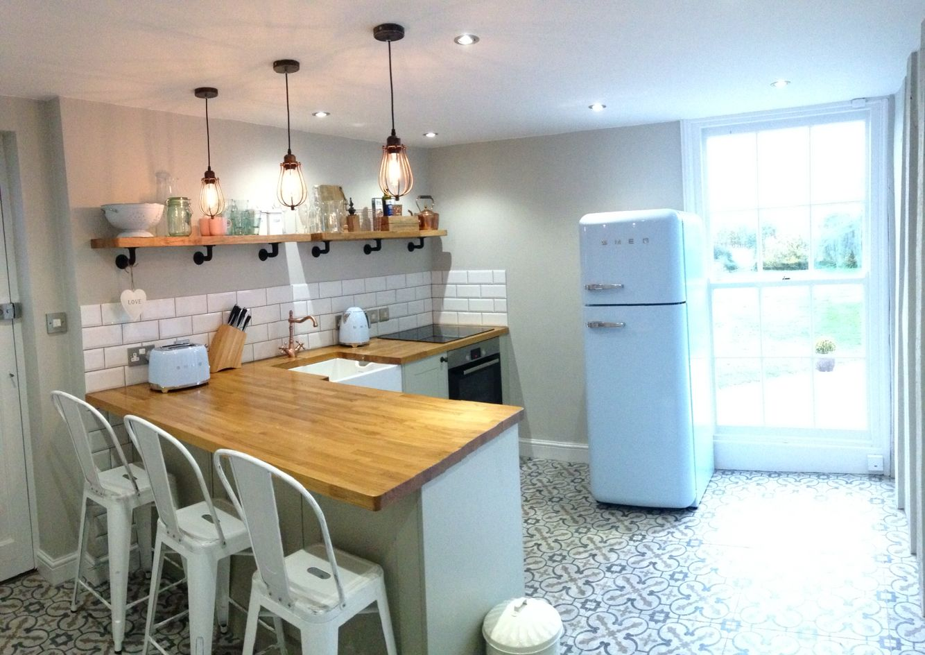 Rustic chic kitchen complete with pastel blue Smeg fridge, kettle ...