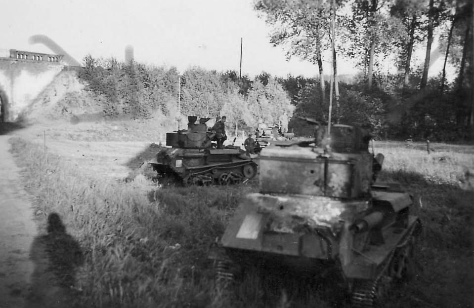 A group of knocked out Vickers Light Tank Mk. IV Bs with the tank in the foreground bearing evidence of rear penetrations - France 1940