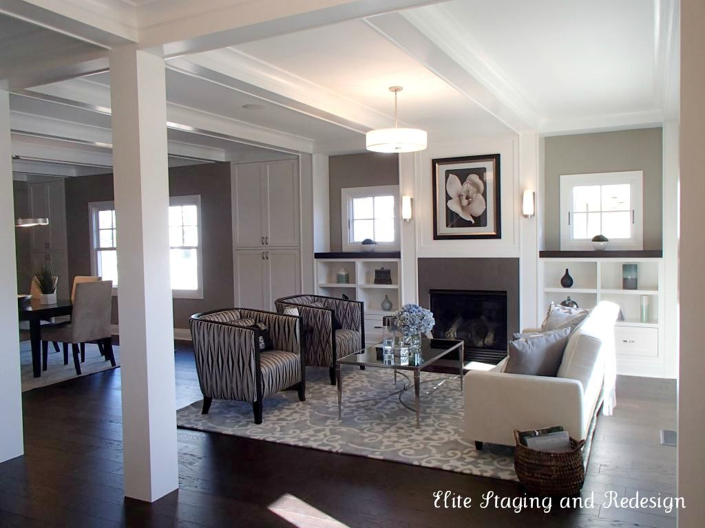 I love these dark hardwood floors and the contrast w area - Dark hardwood floor living room ideas ...