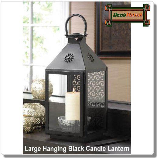 Large Hanging Black Candle Lantern This Large Hanging Candle Lantern Will Give Your Living Space A Splash O Candle Lanterns Large Candle Lanterns Iron Candle