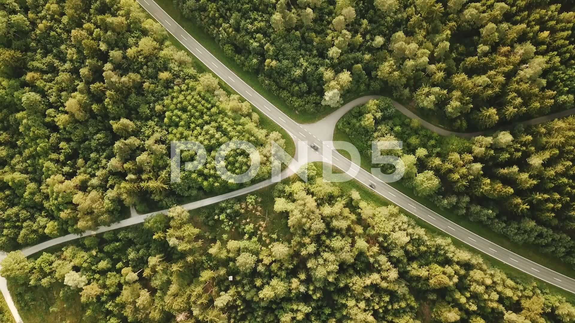 Birds eye tracking shot of country road in forest with light traffic Stock Footage shotcountrytrackingBirds