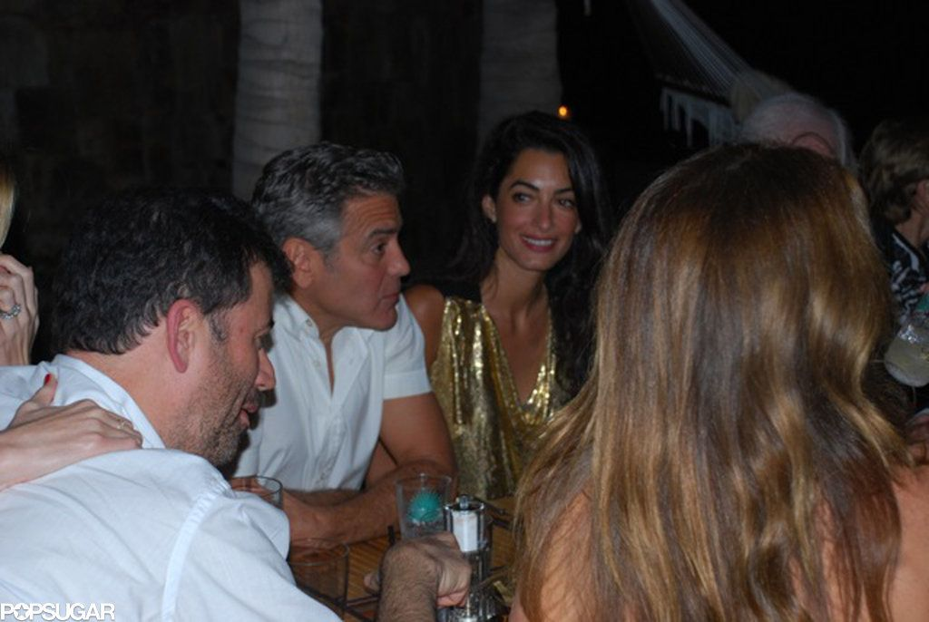 orge Clooney and Amal Alamuddin | The two had a group dinner with friends during their trip to Africa in March 2014.