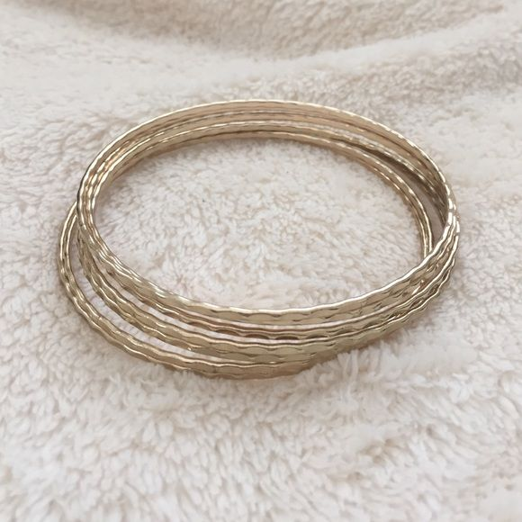 Gold Tone Accent Bangle Bracelets Only used once, like new condition. No discoloration. Every girl needs these in their jewelry box. Fun and flirty. Cute and simple. Must-have statement accessory! 7 bangles in the set. Accessories