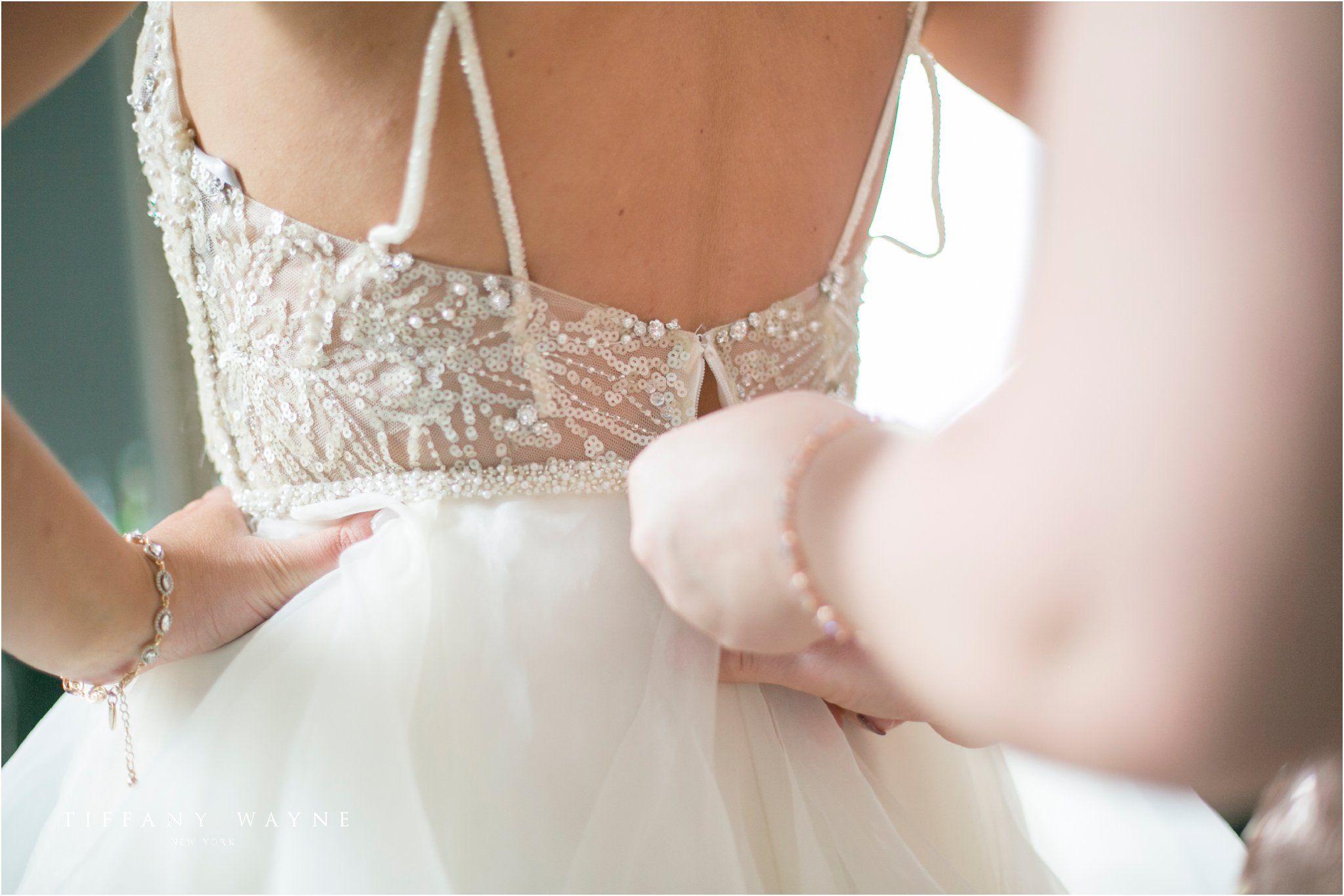 Bride putting on wedding dress photos bride getting ready