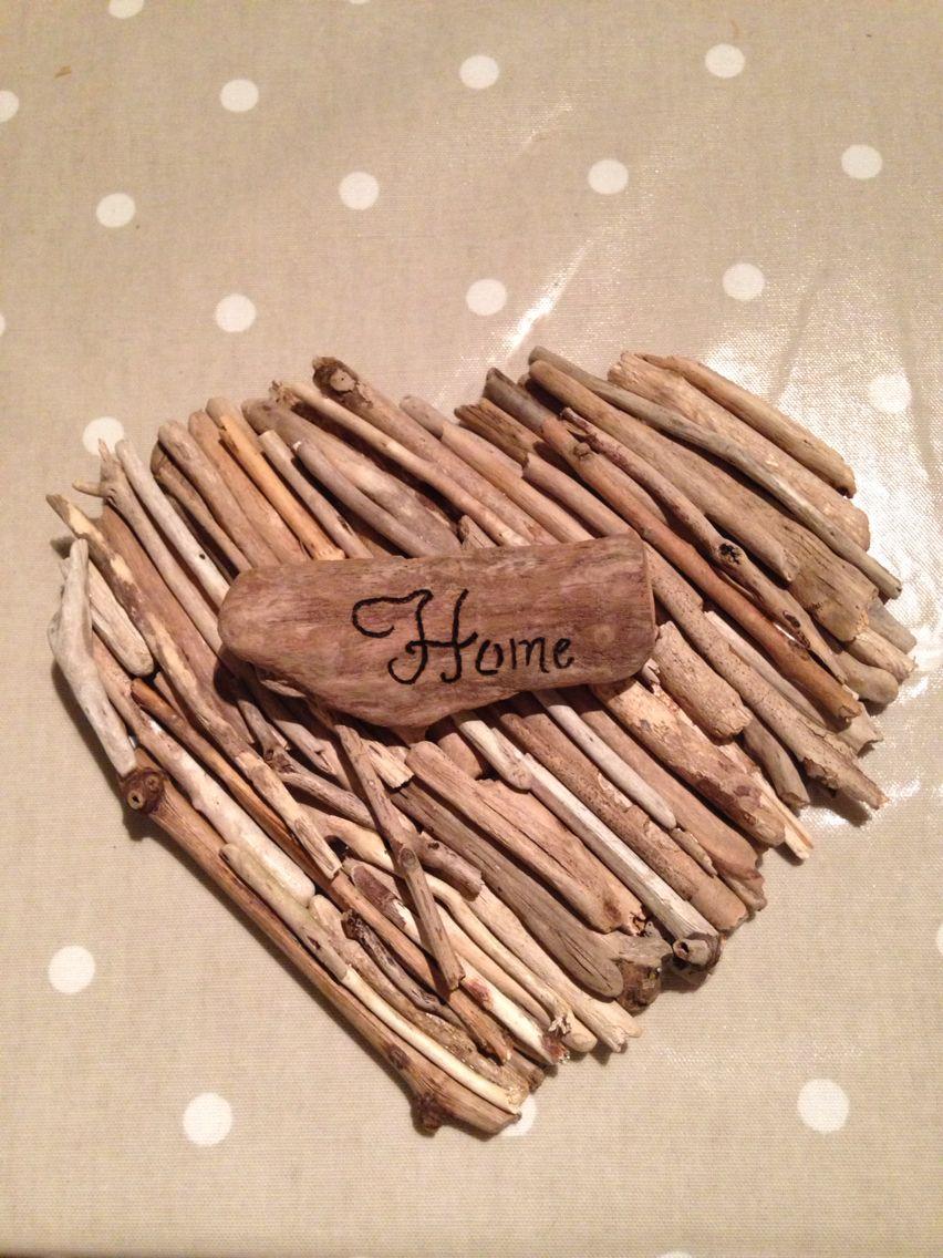 Homemade driftwood heart with driftwood sign