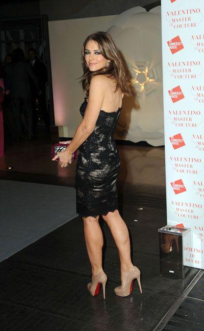 Liz Hurley Wears Her Rafe Dawn Shell And Snakeskin Minaudiere At The Valentino Party Www Rafe Com Elizabeth Hurley Hurley Dress Black Dress