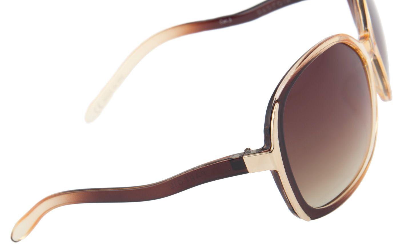 Tijdloze zonnebril van het merk Parfois. Donkerbruine glazen met een goudkleurige monteur met bruine elementen erin.