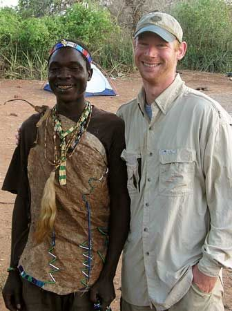 "[Nate Dominy and a Hadza hunter.]   Nate was one of a couple of male researchers that made the female researchers (including me) breakfast for ""National Women's Day"" (on August 9, 2005) at the Transvaal Museum's Researchers' Residence in Pretoria, South Africa. That basically means he's awesome. :)"