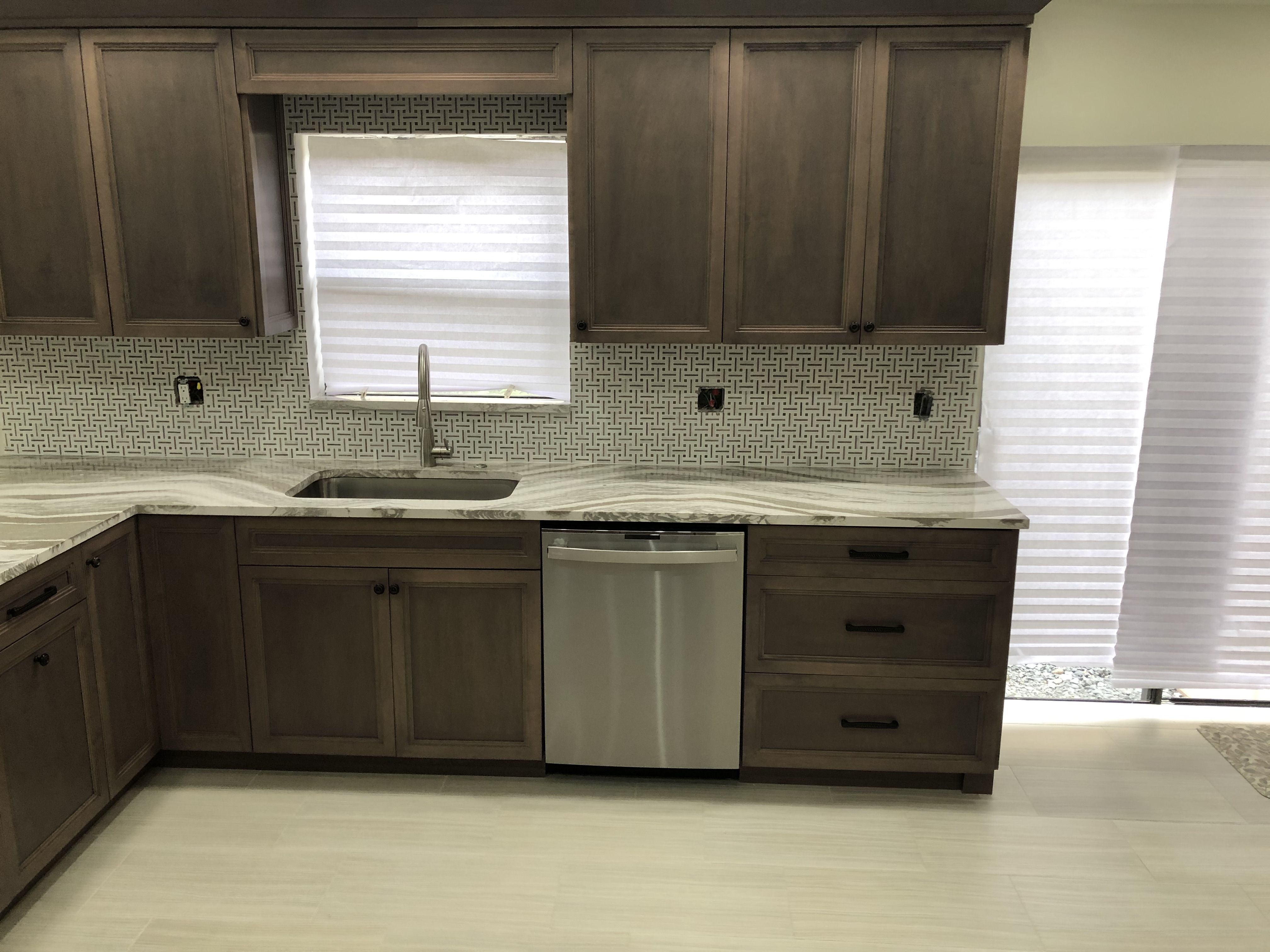 In this kitchen we installed Cambria Oakmoor countertops