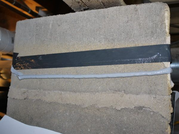 Foundation Tape And Polyurethane Caulk Used To Seal Initially Fasten Vapor Barrier Block