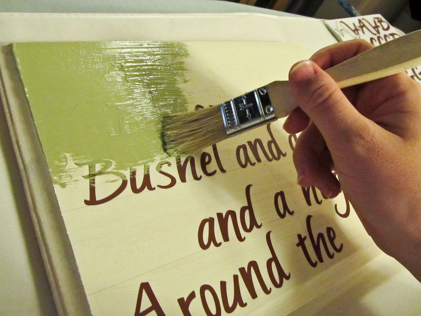 place sticker letters on wooden sign, paint, then peel off stickers. much easier than handwriting!