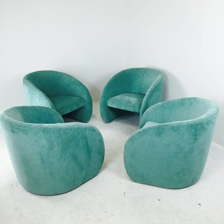 Modern barrel back lounge chairs sold as pairs