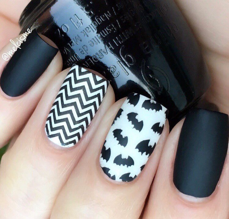 Matte black and white Halloween Bat Manicure by @melcisme ...