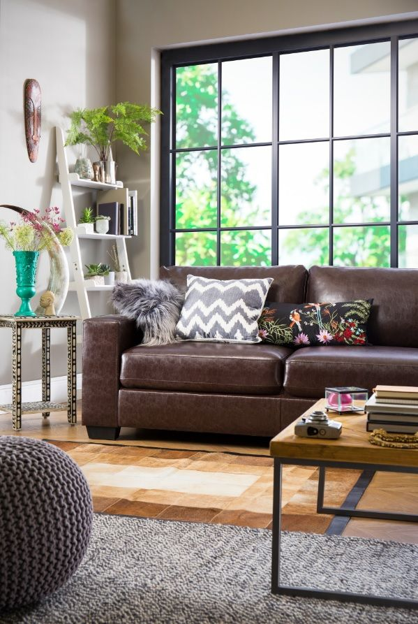 Chestnut brown leather sofa in modern apartment with global inspired ...