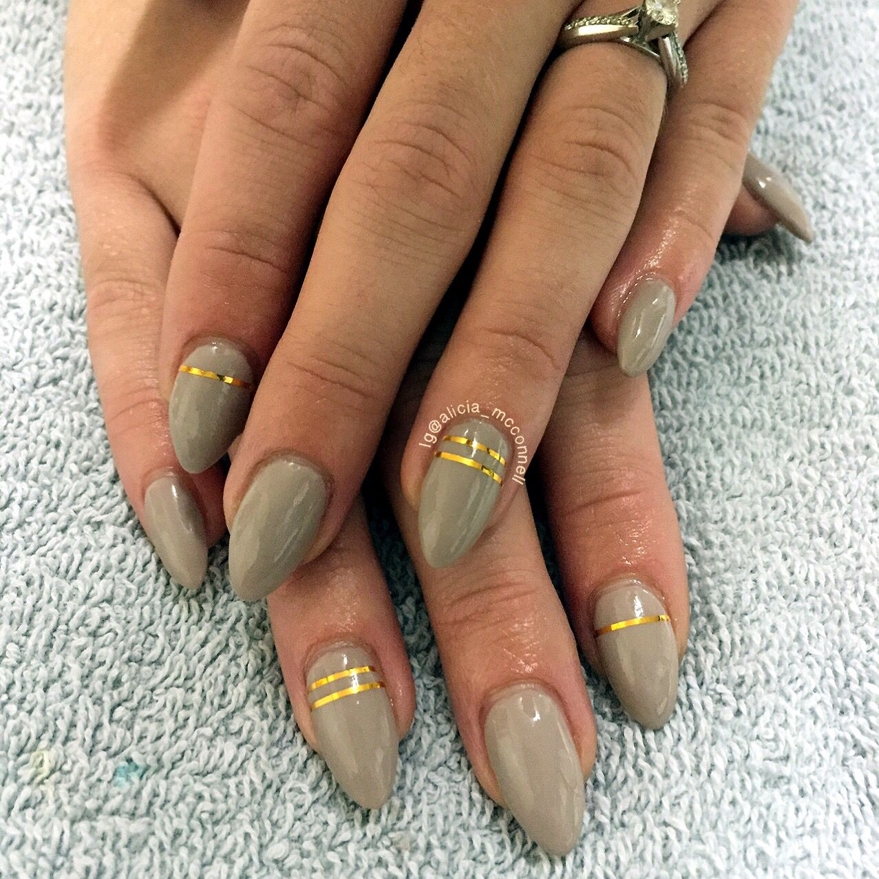 Gray with gold striping tape almond nails | Nails by Alicia ...