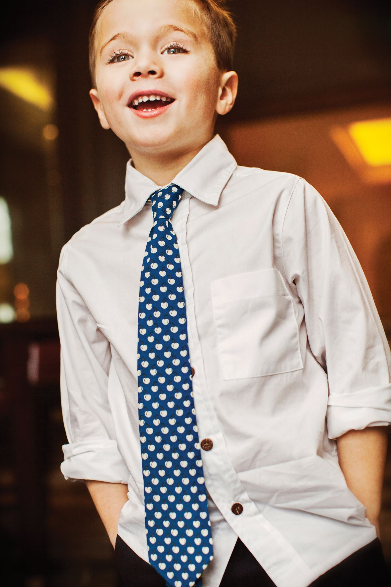 We love a boy in a tie and this one in a crisp blue apple print is an all-time favorite.  #busybeeskids #preppy #boysinties