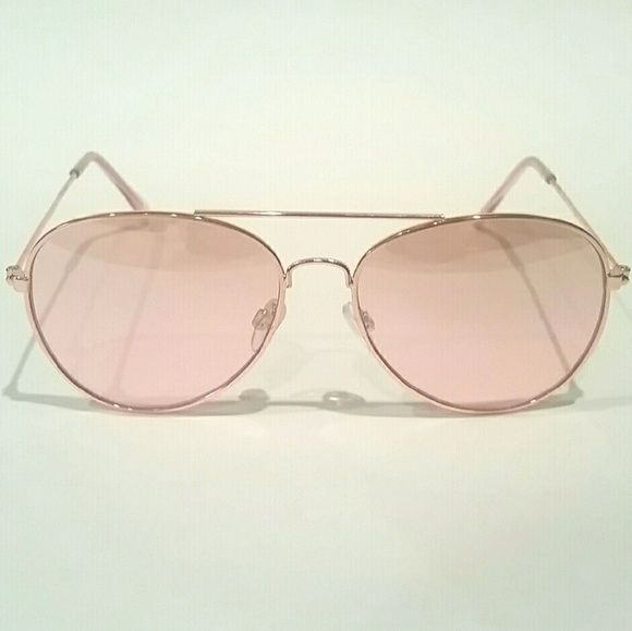 Pink & Gold Aviators Pink & Gold Aviators   - Great condition!  - Worn once  - Pink/Coral lens with matching color on tip of glasses - see photo.   - Gold hardware Accessories Sunglasses