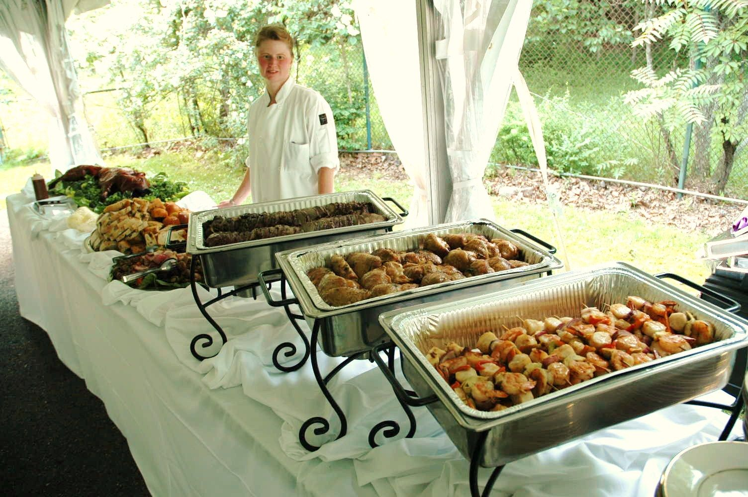 Decorative use of chafing dishes on a buffet table set up for Table buffet