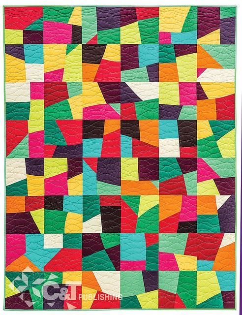 Love this quilt. Plain colours and wavy line quilting