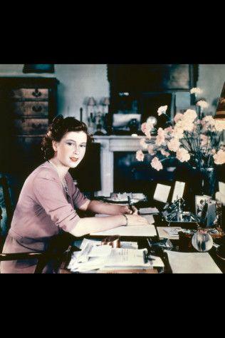 Princess Elizabeth (later Queen Elizabeth II) at her desk in her sitting room at Buckingham Palace, 19th September 1946.