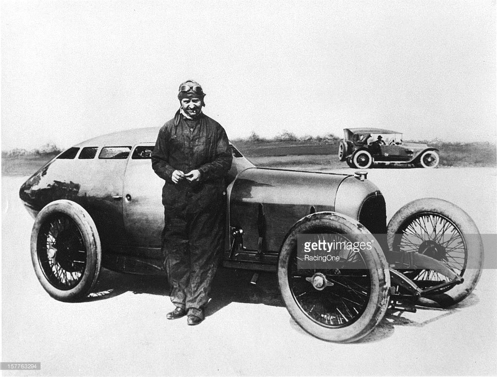 Barney Oldfield with the Golden Submarine streamlined race car ...