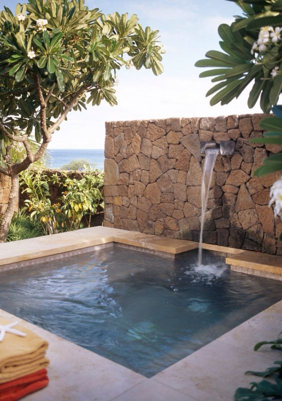 Pool and water feature on stone walling