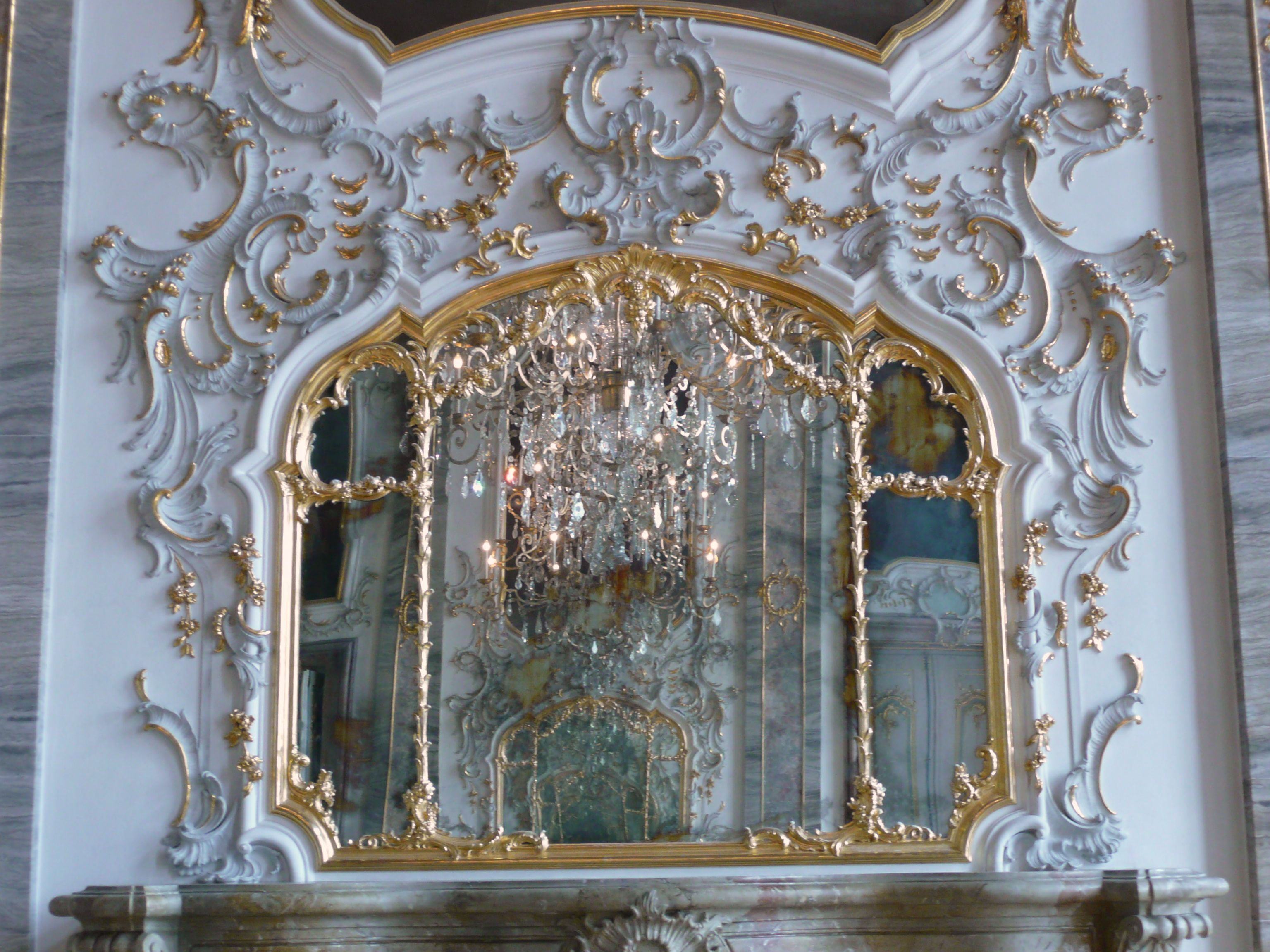 While sanssouci is in the more intimate rococo style and for Rococo style frame