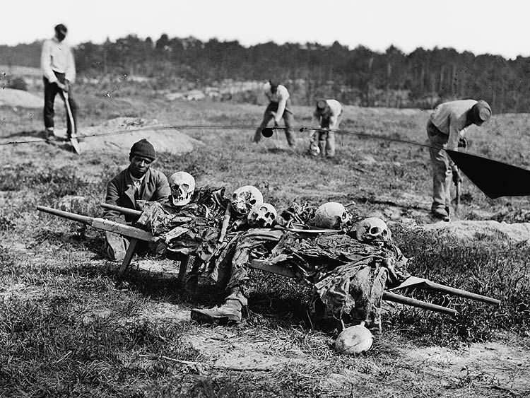 Former slaves collecting bones of soldiers killed in the Battle of Cold Harbor over a year after the battle was fought.