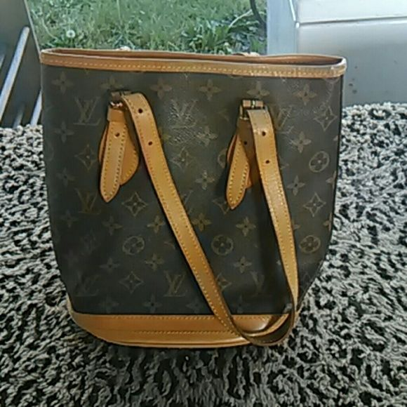 Louis Vuitton Bucket LV bucket bag. The lining is peeling & needs to be replaced, but the outside is perfect, no flaws at all on the the outside leather. Louis Vuitton Bags Shoulder Bags