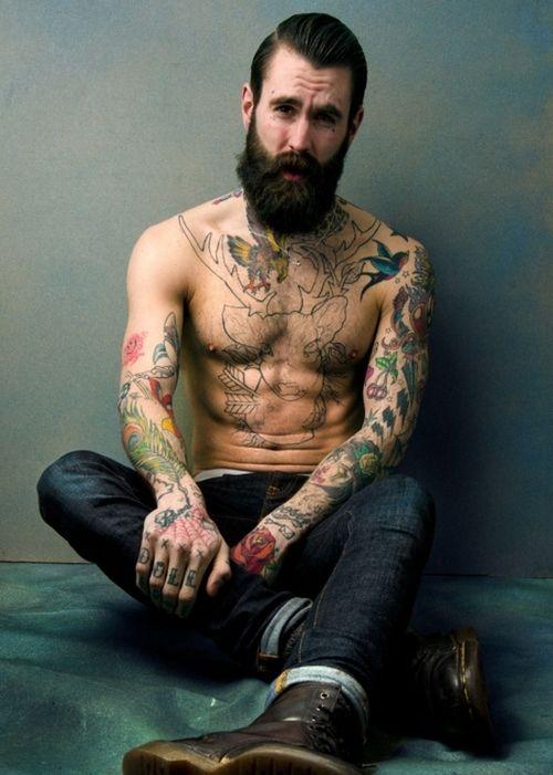 Tattooed man fucks guy