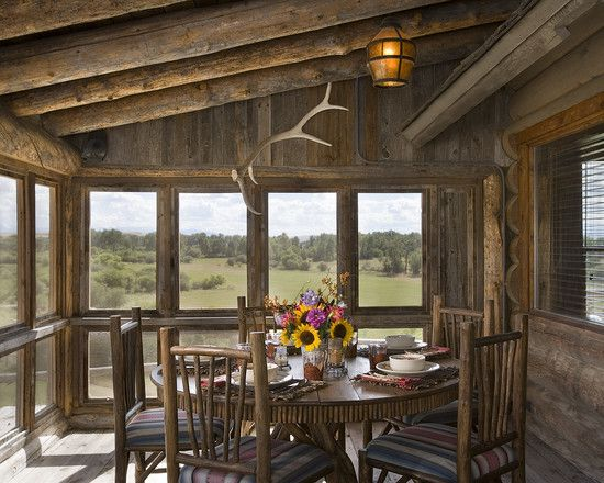 this porch is a bit more rugged western style with large timbers overhead log