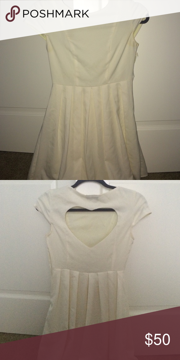 Pleated white heart back dress White pleated heart back dress with sleeves • Size Small • bought from a boutique, brand is Maude • only worn once to graduation! • has side zipper Nordstrom Dresses Mini