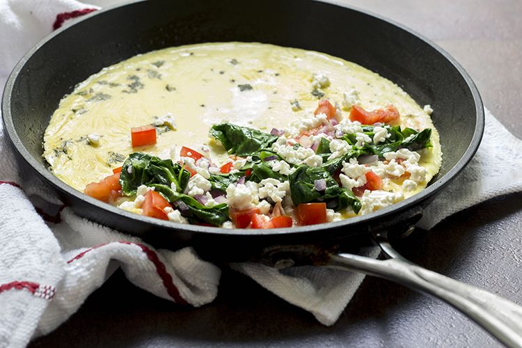 Skinny Greek Omelet 1 Egg White 1 Whole Egg 1 Diced Basil Leaf 1 Tbsp Water 1 Tbsp Red Onion Diced 1 Cup Spinach  C2 Bc Cup Tomato Diced 2 Tbsp Crumbled Feta