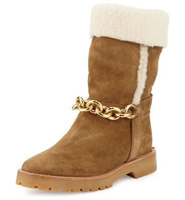 """Raywood fur-cuff ankle-chain boot by Burberry. Burberry suede boot with dyed sheep shearling (Spain) fur trim and lining. 1"""" flat heel with logo plaque at back. Rou..."""