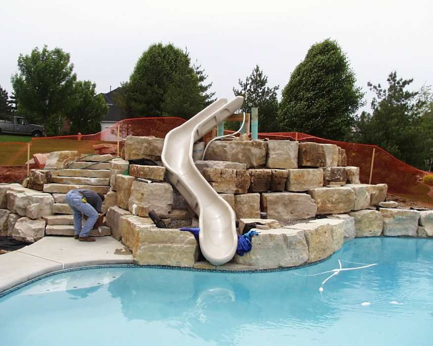 Pool slides custom pool slides more photos click here for Custom inground swimming pools