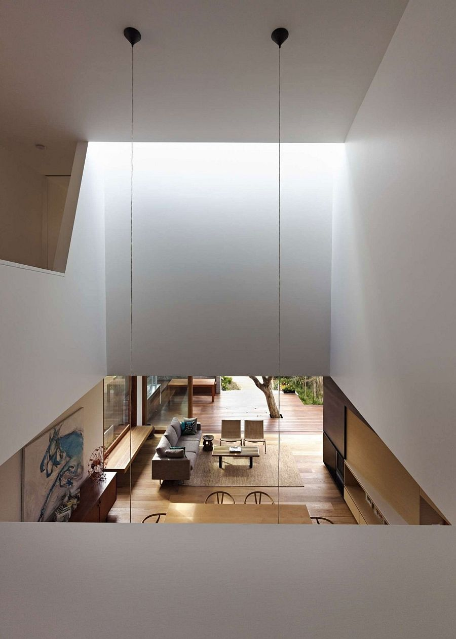 Large skylights and openings allow light to filter down to the lower level