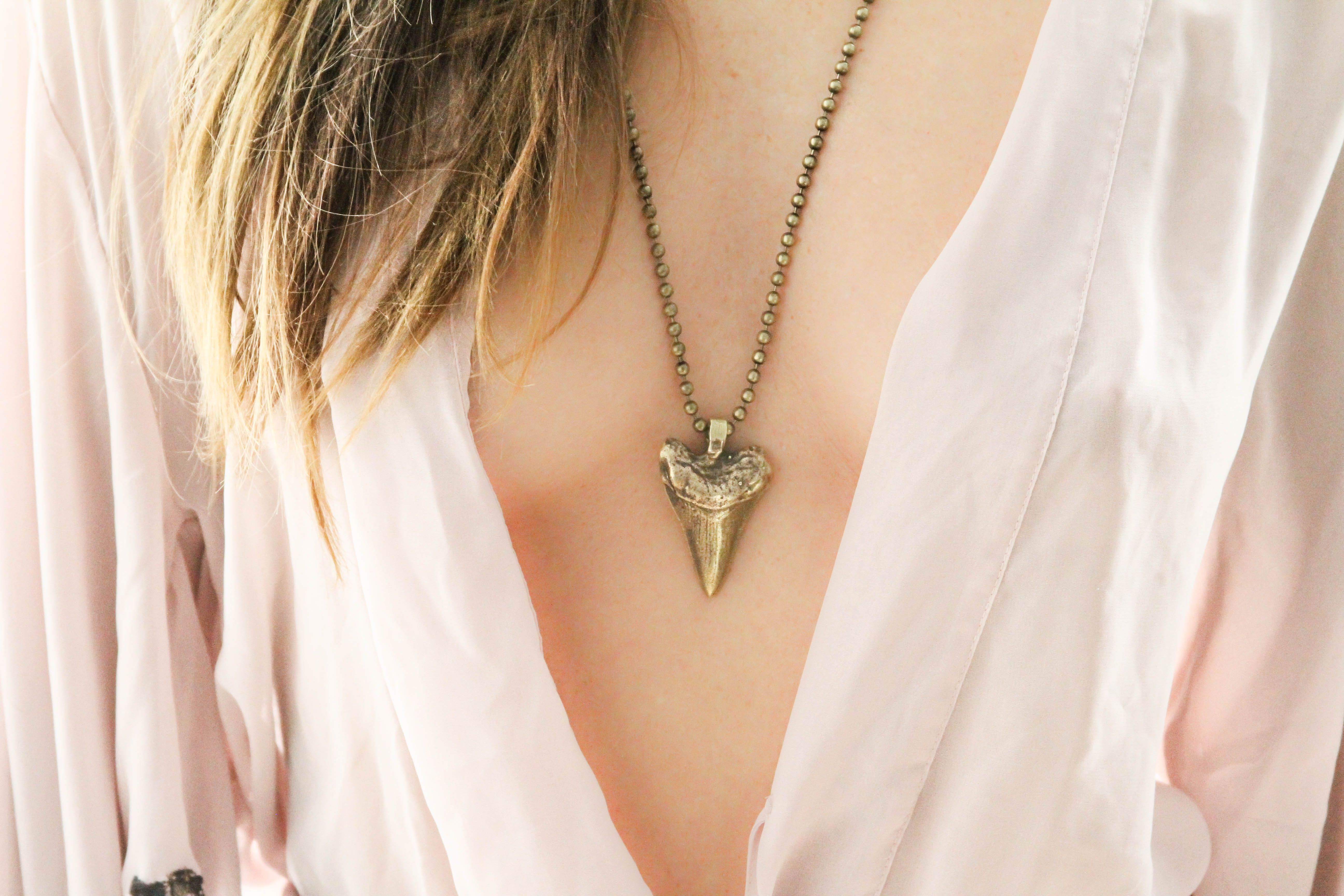 """""""Jaws"""" #fashion #style #swag #street #jewelry #necklace #badass #weapons #brass #bullets #jaws #sharktooth"""
