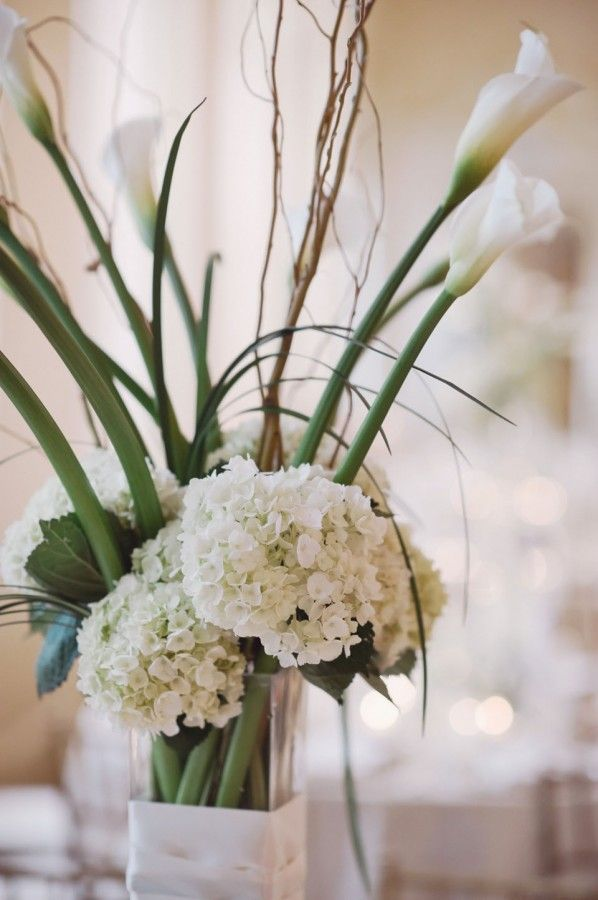 Hydrangeas and calla lily centerpiece modern wedding