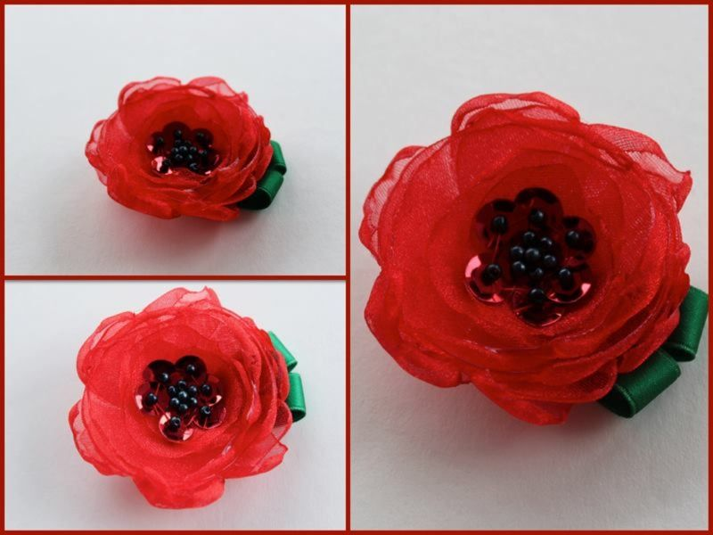 Handmade, embroidered poppy brooches in support of The Royal British Legion.