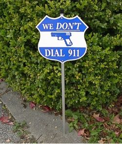 "Show your friends, neighbors and would be intruders who really is protecting your home!    These 11.75"" X 11.75"" badge shaped novelty signs are made of .07"" thick white polyethylene. Designs are screen printed with UV protected ink. Signs are assembled to aluminum stakes with single piece aircraft strength pressure sensitive rivets.    3M dual sided bonding tape is also applied between rivets to increase overall strength."