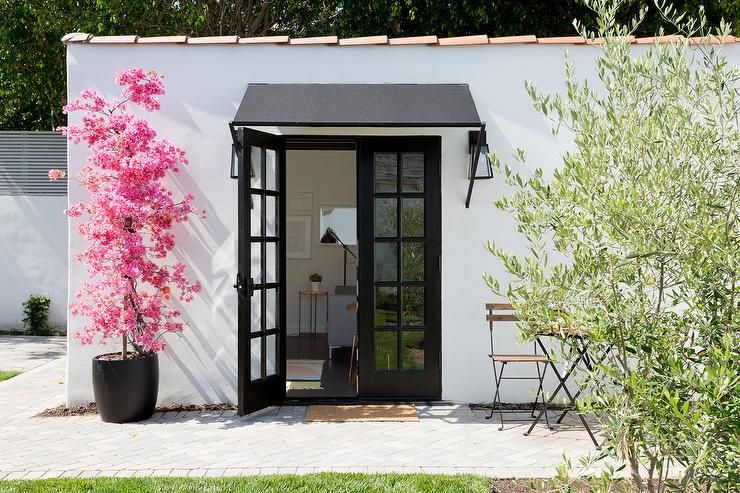Contemporary Patio Features Black French Doors With A Matching