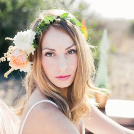 Bohemian inspired session with a pastel color palette, flower headpiece, and tassel garland.