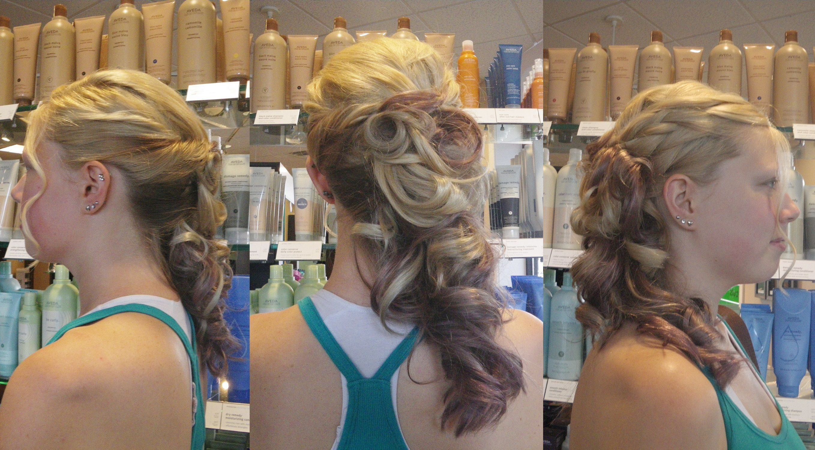 a lovely updo with some intricate braiding through the top... notice her burgundy-purple color sneaking in the mix of curls!