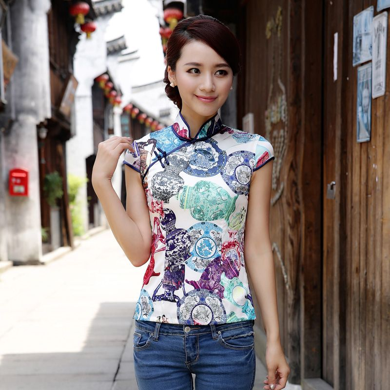 Please click on each Chinese blouse below for detailed information. We offer Chinese silk blouses, Chinese brocade blouses, wealth flower blouses, embroidered Chinese blouses, Chinese dragon blouse, dragon and phoenix blouses, Chinese blouses with good fortune symbols.