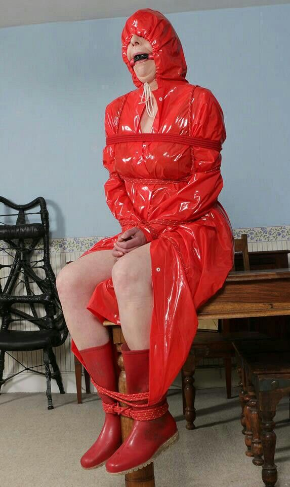 Bondage in plastic rainwear